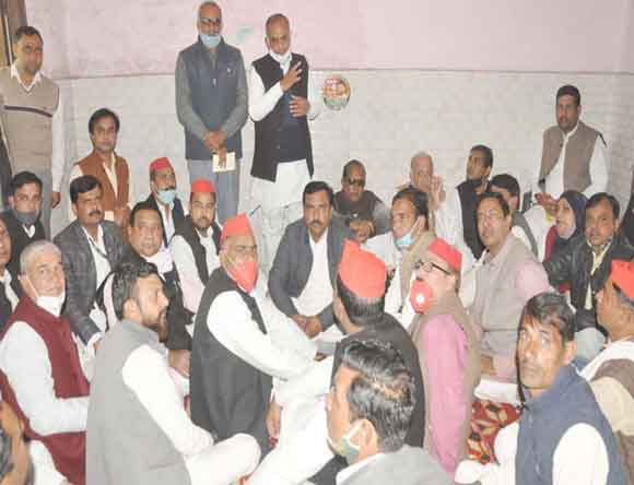 Addressing District President Ch. Rudrasain